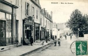 Nexon rue du centre depuis eglise fete sur la place